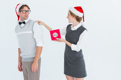 Geeky hipster offering present to her boyfriend Royalty Free Stock Photography