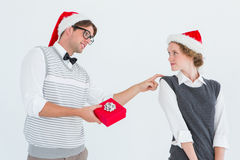 Geeky hipster offering present to his girlfriend Royalty Free Stock Photo