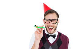 Geeky hipster in party hat with horn Stock Photography