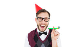 Geeky hipster in party hat with horn Royalty Free Stock Photo