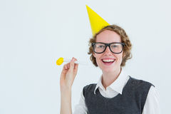 Geeky hipster in party hat with horn Royalty Free Stock Photos