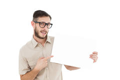 Geeky hipster pointing at poster Stock Photography