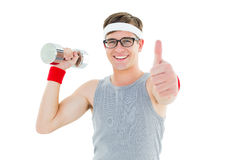 Geeky hipster posing in sportswear with dumbbell Royalty Free Stock Images