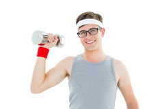 Geeky hipster posing in sportswear with dumbbell Stock Image