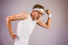 Geeky hipster posing in sportswear Stock Image
