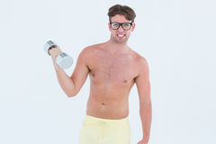 Geeky hipster posing topless with dumbbell Royalty Free Stock Photos