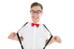 Geeky hipster pulling his suspenders Royalty Free Stock Photo