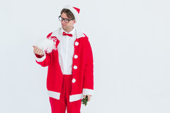 Geeky hipster in santa costume looking at beard Royalty Free Stock Image