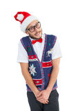 Geeky hipster in santa hat Royalty Free Stock Images