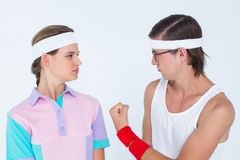 Geeky hipster showing fist to his girlfriend Stock Photos