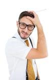 Geeky hipster som skrapar hans huvud Fotografering för Bildbyråer