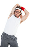 Geeky hipster stretching in sportswear Royalty Free Stock Image