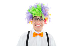 Geeky hipster wearing a rainbow wig Royalty Free Stock Photography