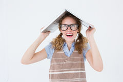 Geeky hipster woman covering her head with her laptop Royalty Free Stock Photography