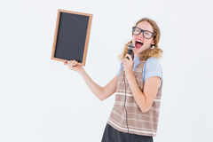 Geeky hipster woman holding blackboard and singing into microphone Stock Photos