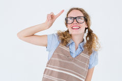Geeky hipster woman pointing up. On white background Royalty Free Stock Photo