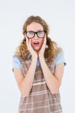 Geeky hipster woman putting her fingers in her ears Royalty Free Stock Image