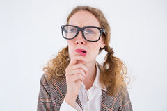 Geeky hipster woman thinking with hand on chin Stock Photos