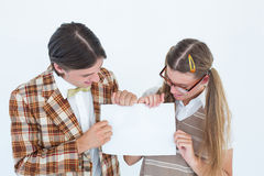 Geeky hipsters holding a poster Royalty Free Stock Photos