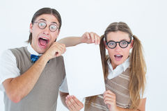Geeky hipsters holding a poster Stock Images