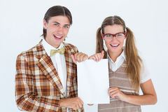 Geeky hipsters holding a poster Royalty Free Stock Photography