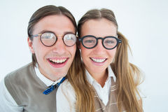 Geeky hipsters smiling at camera Stock Photos