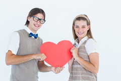 Geeky hipsters smiling at camera Royalty Free Stock Image
