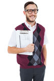 Geeky man holding clipboard in vest Stock Photo