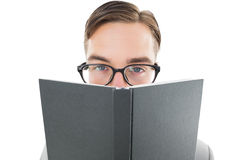 Geeky man looking over book Stock Photos