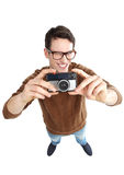Geeky man with vintage camera Stock Photo