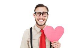 Geeky modniś uśmiecha się serce kartę i trzyma Obrazy Stock