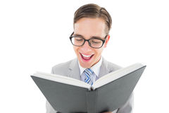 Geeky preacher reading from black bible Royalty Free Stock Image