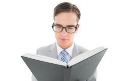 Geeky preacher reading from black bible Stock Images