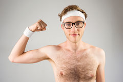 Geeky shirtless hipster flexing bicep Stock Photography