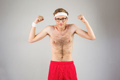 Geeky shirtless hipster flexing biceps Stock Photos