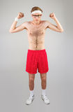 Geeky shirtless hipster flexing biceps Royalty Free Stock Photos