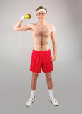Geeky shirtless hipster posing with dumbbell Stock Photo