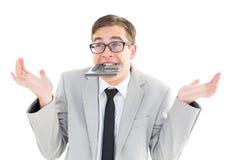 Geeky shrugging businessman biting calculator Stock Images