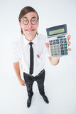 Geeky smiling businessman showing calculator Stock Images