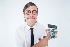 Geeky smiling businessman showing calculator Royalty Free Stock Images