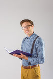 Geeky student reading a book Royalty Free Stock Photo