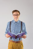 Geeky student reading a book Royalty Free Stock Images