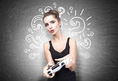 Geeky teen with video game controller Royalty Free Stock Photo
