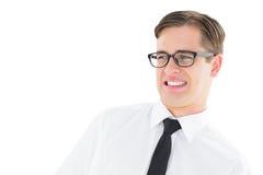 Geeky ung hipster som ser med avsmak fotografering för bildbyråer