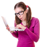 Geeky woman with a laptop Royalty Free Stock Photo