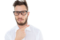 Geeky young businessman looking at camera and pointing Royalty Free Stock Photo