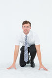 Geeky young businessman ready to race Royalty Free Stock Photo