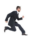 Geeky young businessman running mid air Stock Image