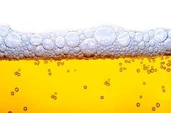 Geel bier met schuim Stock Fotografie