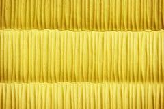 Geel de oppervlaktepatroon van de doekspons Stock Foto's